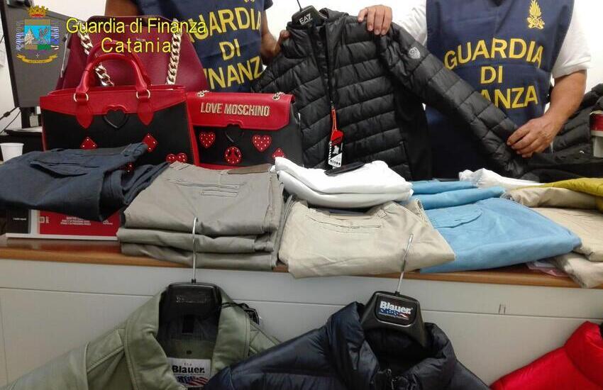 Guardia di Finanza, sequestri a Giarre e Zafferana di abbigliamento contraffatto. Denunciato imprenditore
